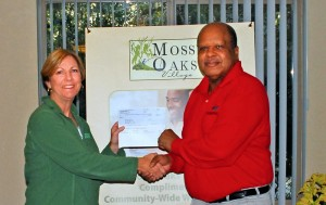 Accepting a DOnation from Mos Oaks Village